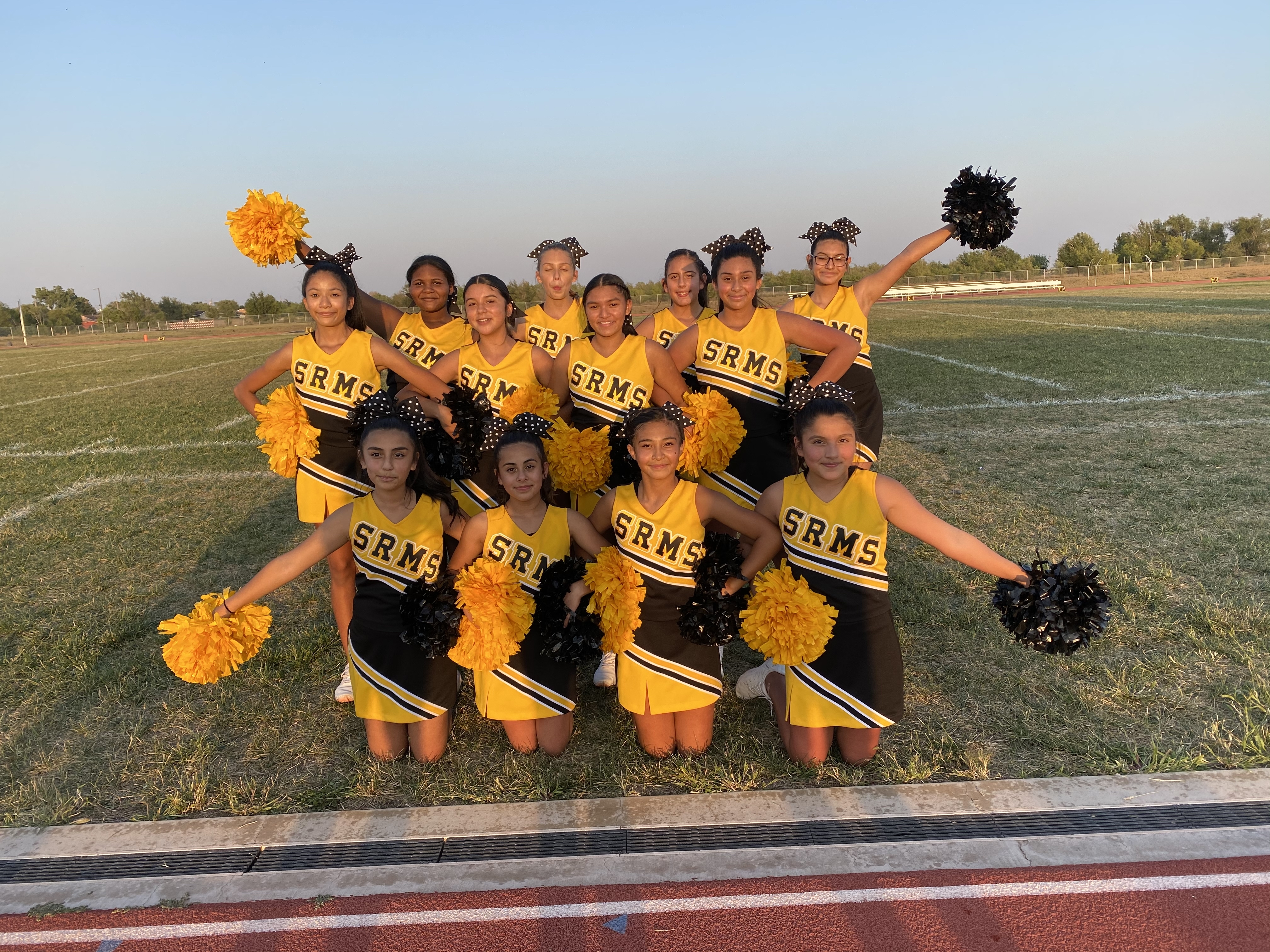 SRMS Cheer rocking their new uniforms!! 💛🖤